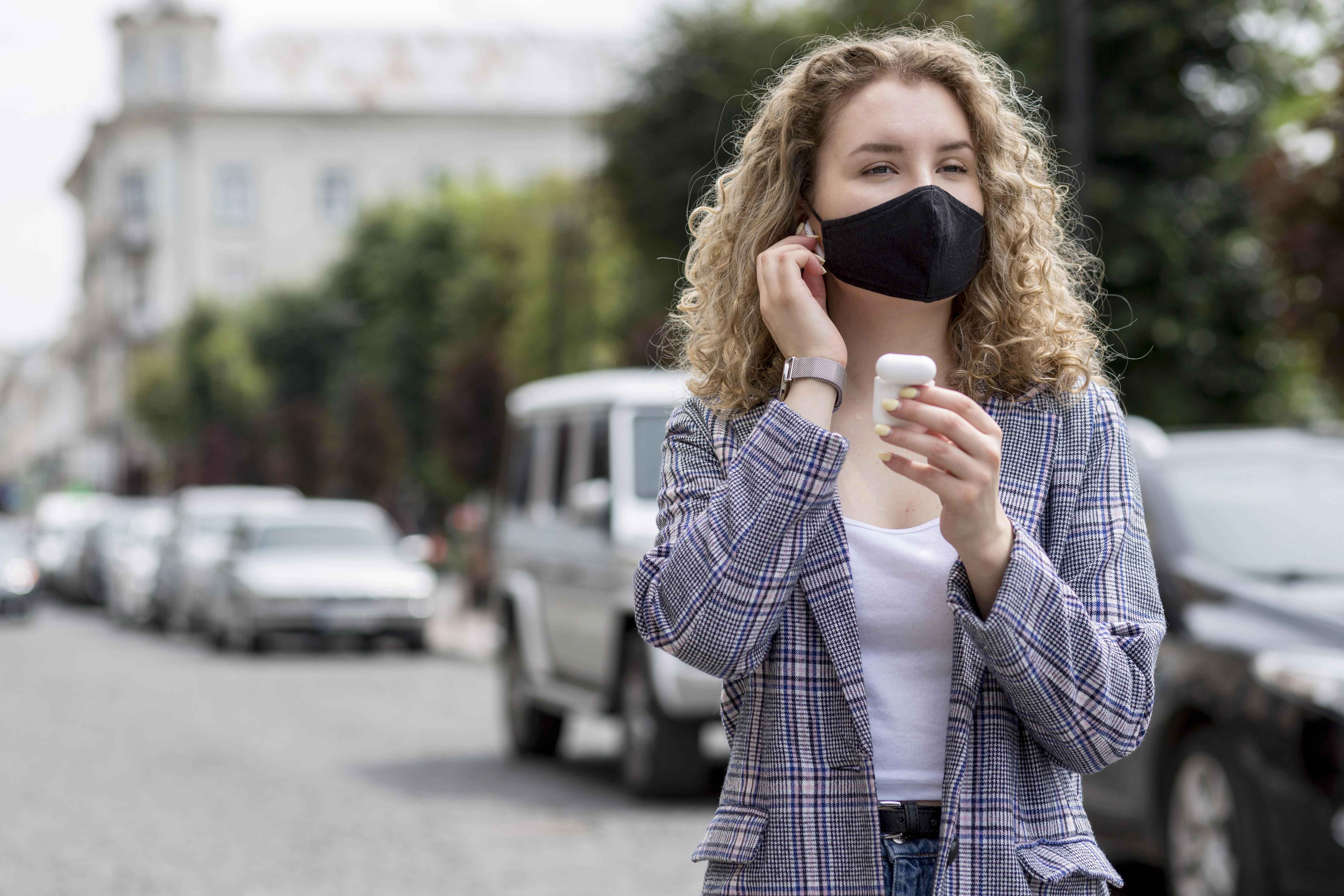 woman-with-mask-outdoor-with-airpods.jpg