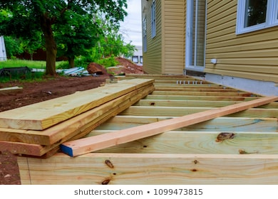 new-wooden-timber-deck-being-260nw-1099473815.jpg