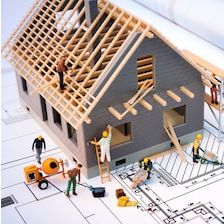 building-house-on-blueprints-worker-260nw-271171484.jpg